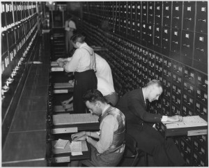 Part of the biggest bookeeping job in the world: Filing workers' applications for social security account numbers. This photo is in the public domain and is available This media is available in the holdings of the National Archives and Records Administration.